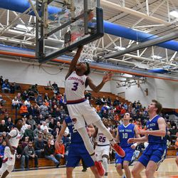 Curie's DaJuan Gordon (3) (3) gets a lay up off the backboard, Friday 12-28-18. Worsom Robinson/For Sun-Times