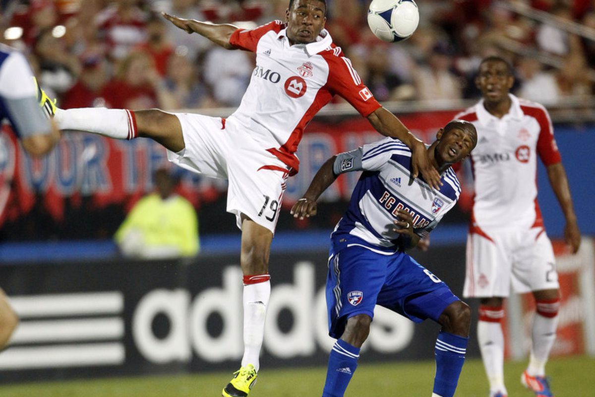 FRISCO, TX - JULY 4:  Reggie Lambe #19 of Toronto FC heads the ball away from Jackson #6 of FC Dallas at FC Dallas Stadium on July 4, 2012 in Frisco, Texas. (Photo by Layne Murdoch/Getty Images)
