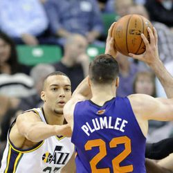 Utah Jazz center Rudy Gobert (27) defends Phoenix Suns center Miles Plumlee (22) during a game at EnergySolutions Arena on Wednesday, Feb. 26, 2014.