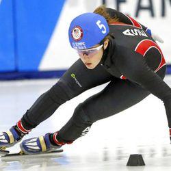 Katherine Reutter-Adamek (5) competes in the women's 1000-meter during the U.S. Olympic short track speedskating trials Sunday, Dec. 17, 2017, in Kearns, Utah. (AP Photo/Rick Bowmer)