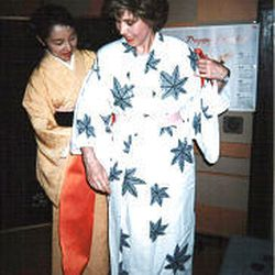 Alice Steinbach tries on a kimono. In Japan she learned the secrets of geishas.