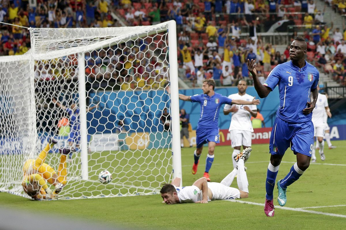 Italy's Mario Balotelli celebrates after scoring past England's goalkeeper Joe Hart in the 2014 World Cup. England has not had much success against Italy over the years.