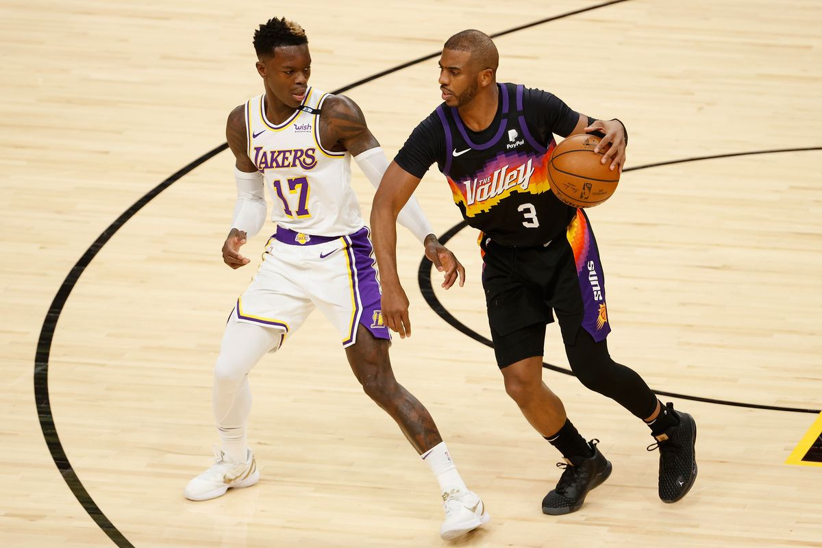 Chris Paul #3 of the Phoenix Suns handles the ball against Dennis Schroder #17 of the Los Angeles Lakers during the first half of Game One of the Western Conference first-round playoff series at Phoenix Suns Arena on May 23, 2021 in Phoenix, Arizona.