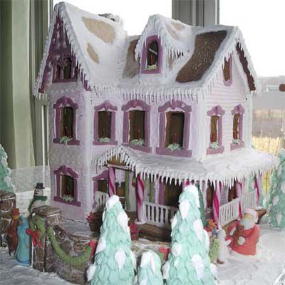 Gingerbread home with purple windows and candy kane pillars.