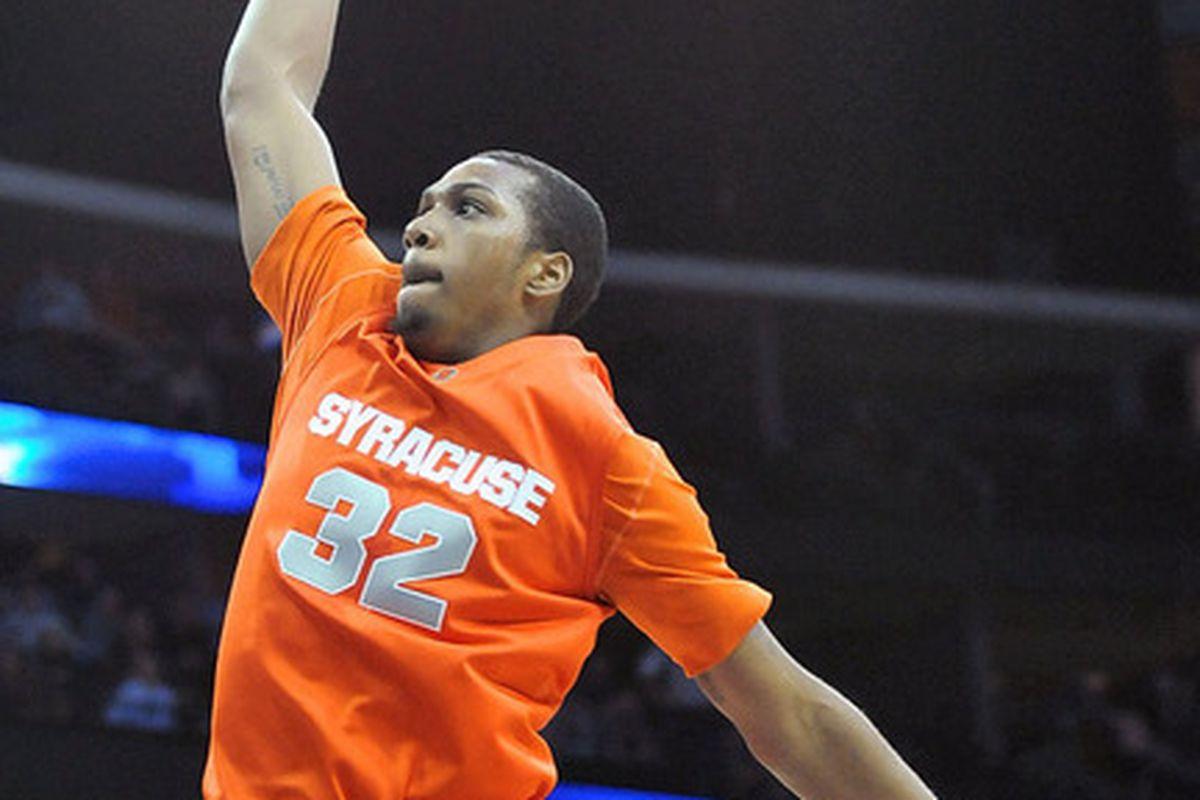 Kris Joseph soars off the bench for the 4th ranked Orange. (Dennis Nett)