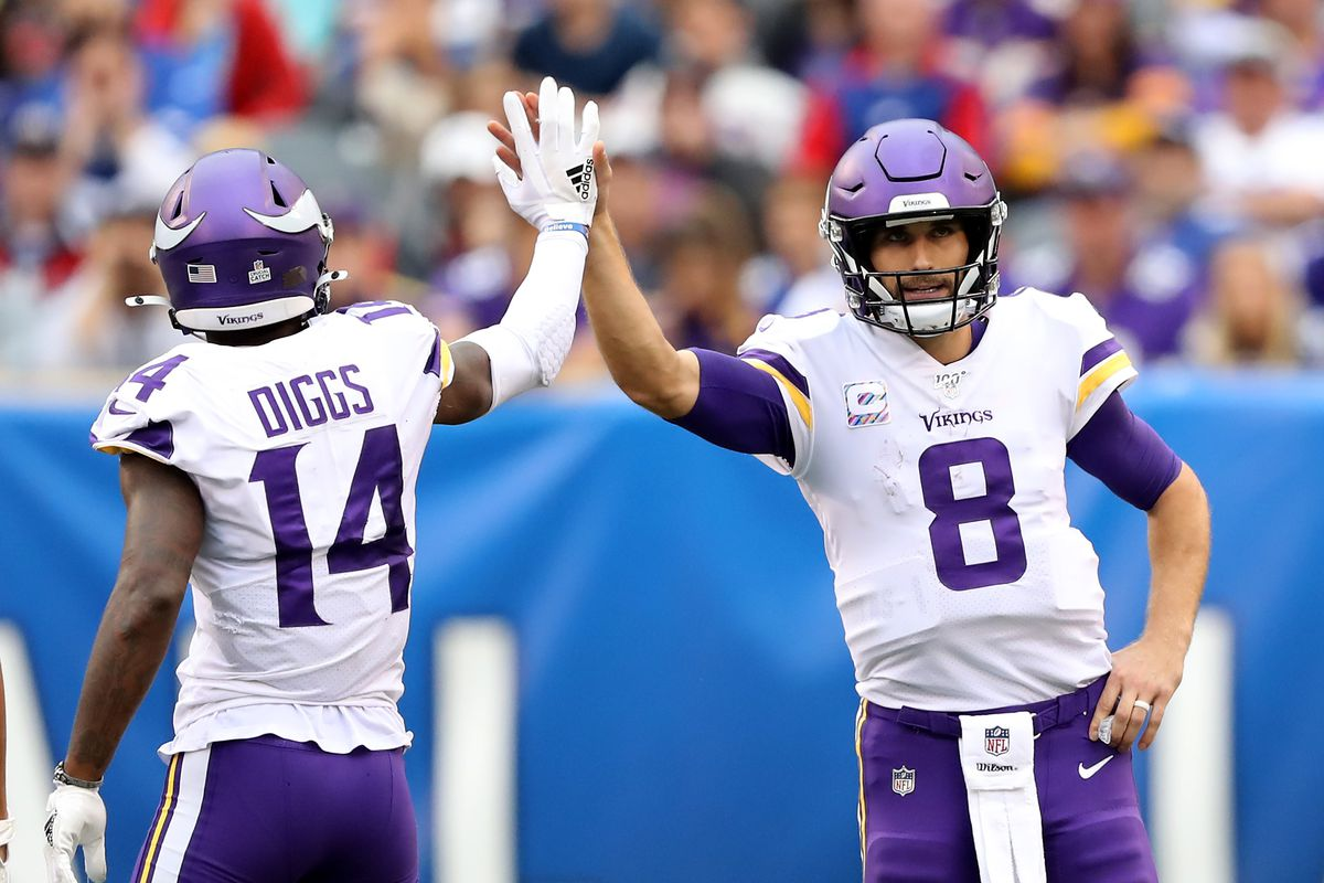 Kirk Cousins of the Minnesota Vikings congratulates Stefon Diggs after a catch in the fourth quarter against the New York Giants at MetLife Stadium on October 06, 2019 in East Rutherford, New Jersey.