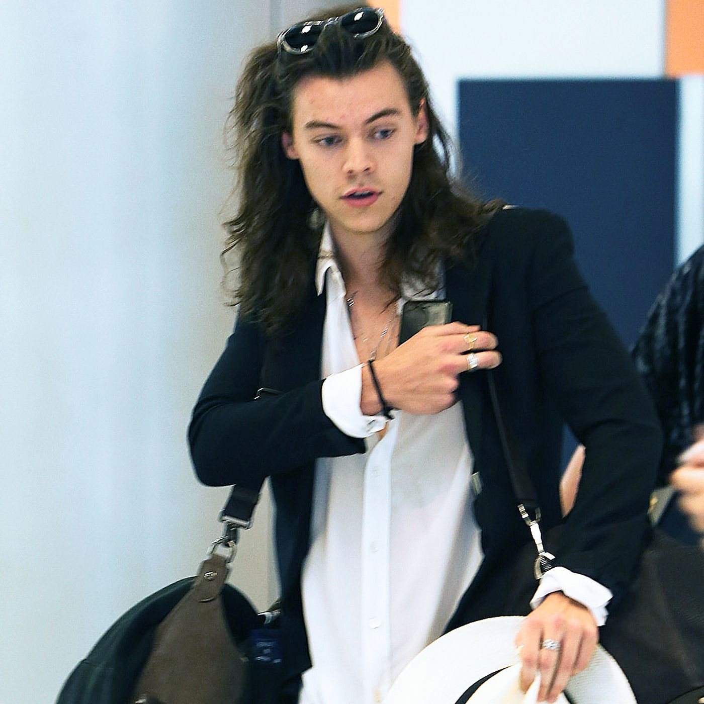 Harry Styles Accessorizes Bright White Hat With Airport Racked