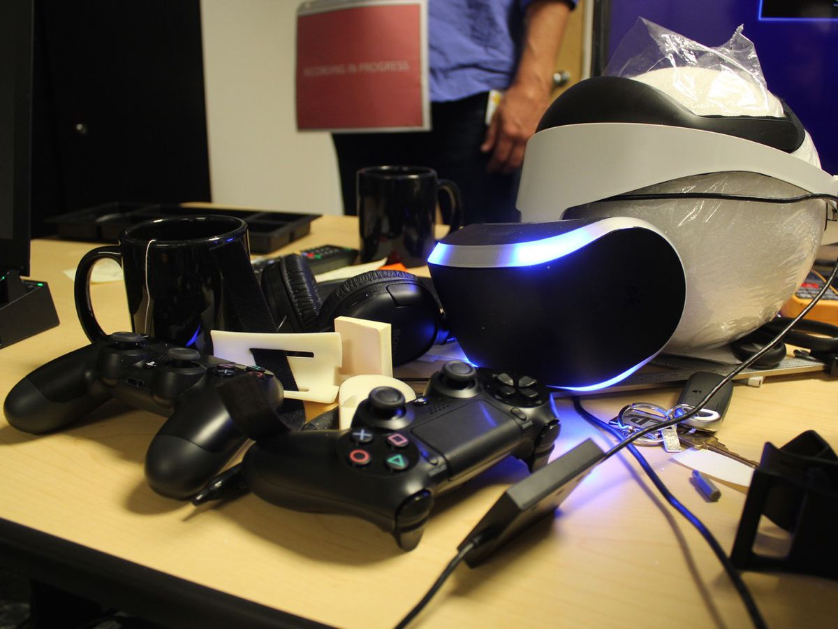 Two PlayStation controllers and a prototype of the Magic Lab's virtual reality headset, Project Morpheus