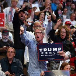 Supporters of Republican presidential candidate Donald Trump yell at reporters as they arrive for a campaign rally on Oct. 13, 2016, in Cincinnati, Ohio.