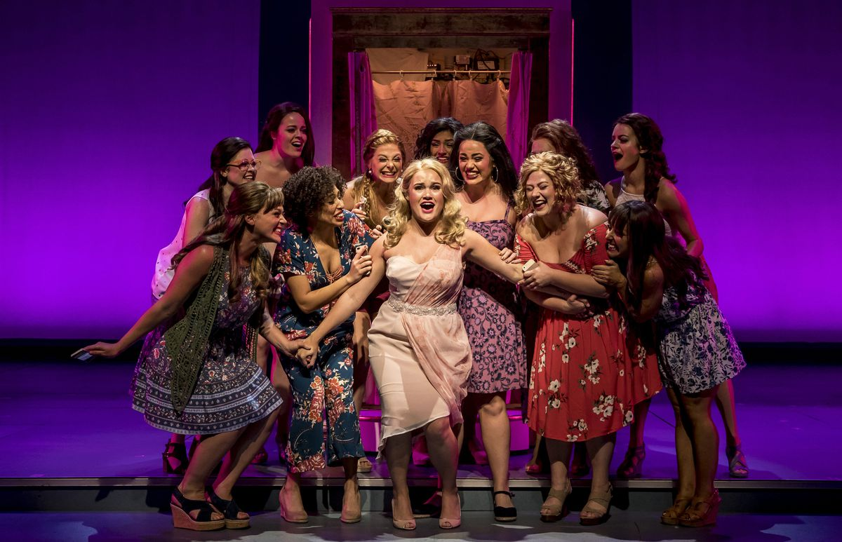 """Casey Shuler (center) plays Elle Woods in the Paramount Theatre production of """"Legally Blonde."""" Also pictured: flanked by (front, left) Jacquelyne Jones, Kyrie Courter (right) Lucy Godinez, Sara Reinecke and Jenna Coker-Jones, with (back row, from left) L"""
