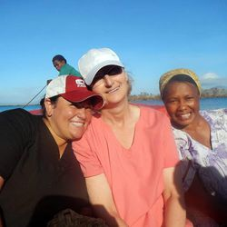 Accompanied by locals, nurses Whitney Davidson and Cheryl Wynkoop travel by boat from the island of Emao to Efate, the island of Vanuatu's capital, Port Vila.