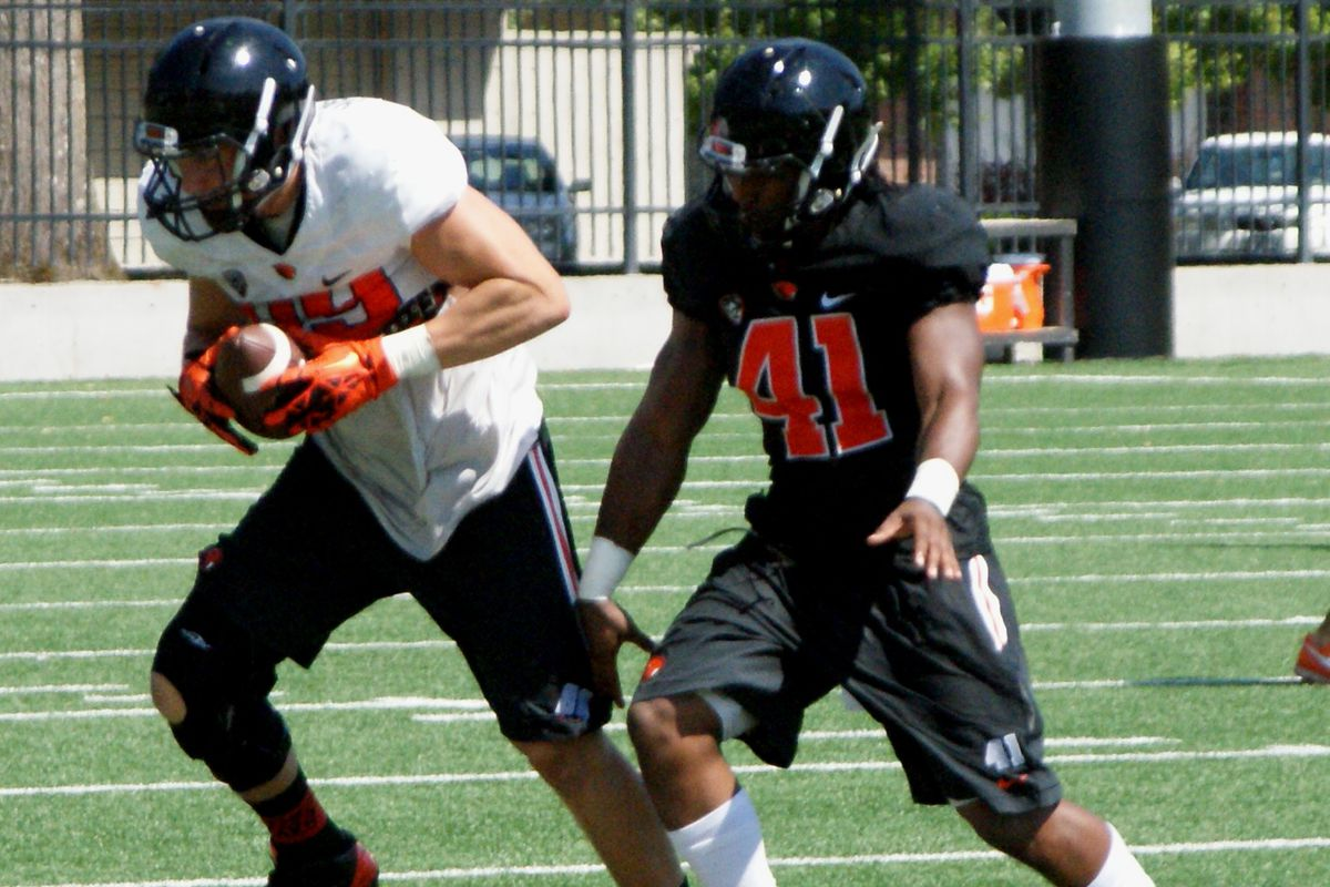 Darrell Songy, 41, defending Connor Hamlett in practice last fall, was expected to start at OLB this season for Oregon St.