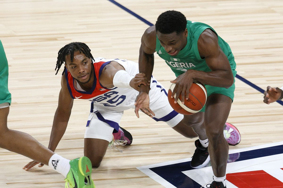 Darius Garland #25 of the United States fouls Caleb Agada #3 of Nigeria during an exhibition game at Michelob ULTRA Arena ahead of the Tokyo Olympic Games on July 10, 2021 in Las Vegas, Nevada.