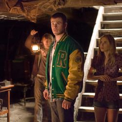 """Marty (Fran Kranz), left, Curt (Chris Hemsworth), center, and Jules (Anna Hutchison) in """"The Cabin in the Woods."""""""