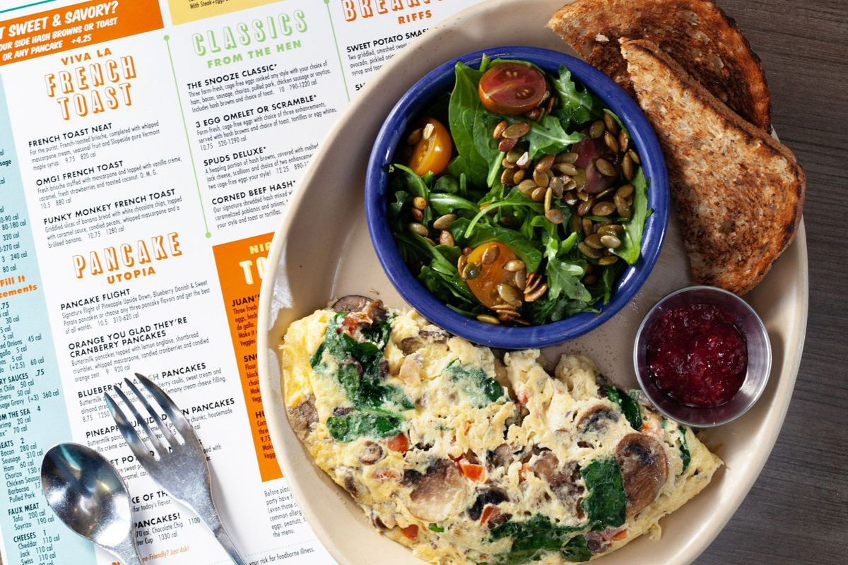 A vegetable omelette with a side salad and wheat toast at Snooze