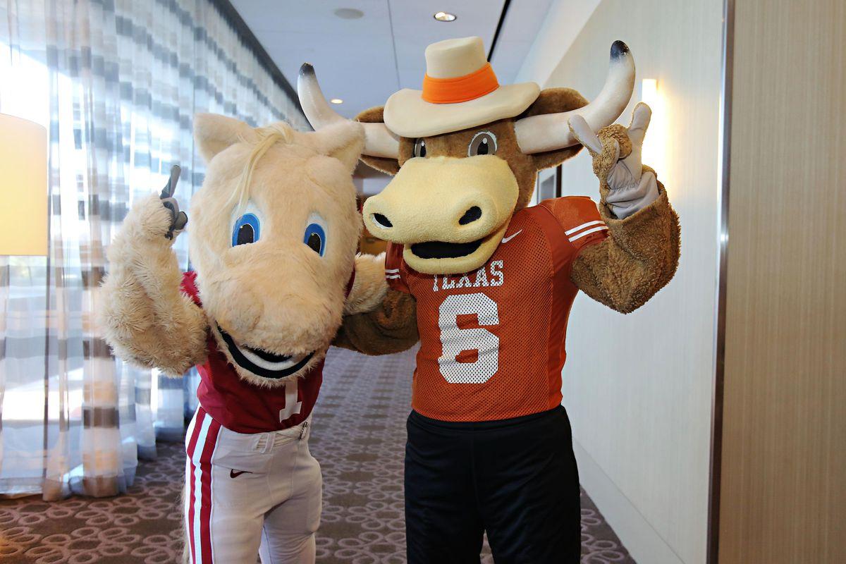Jul 23, 2012; Dallas, TX, USA; Oklahoma Sooners mascot Boomer poses for a photo with Texas Longhorn mascot Hook Em during Big 12 Media Day at the Westin Galleria.  Mandatory Credit: Kevin Jairaj-US PRESSWIRE