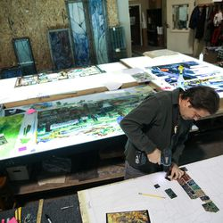 """Tom Holdman works on """"The Roots of Knowledge,"""" a 200-foot-long stained glass installation for Utah Valley University, at Holdman Studios in Lehi on Friday, Nov. 4, 2016. The university announced a $1.5 million donation from philanthropists Marc and Deborah Bingham that will enable the completion of the massive stained glass installation."""