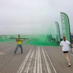 Daphne Brass runs toward color station No. 2 — green — during last month's Color Run in Irvine, Calif.