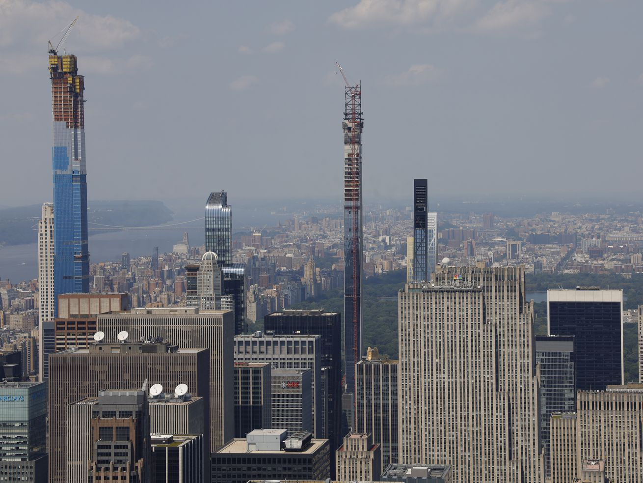 Three supertall, skinny skyscrapers jut out of the midtown skyline.