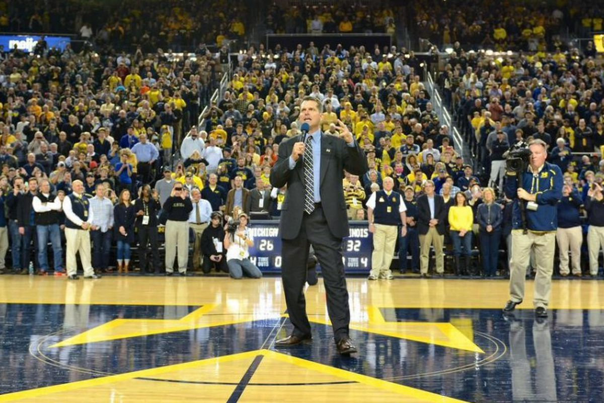 """Jim Harbaugh is not wearing khakis for once. Photo via <a href=""""http://levistrauss.com/unzipped-blog/2015/01/jim-harbaugh-inspires-michigan-fans-to-khakiout/"""">Unzipped</a>"""