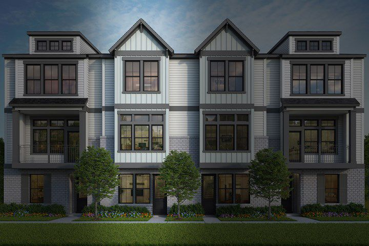 A series of white brick townhomes with a variety of roofs.