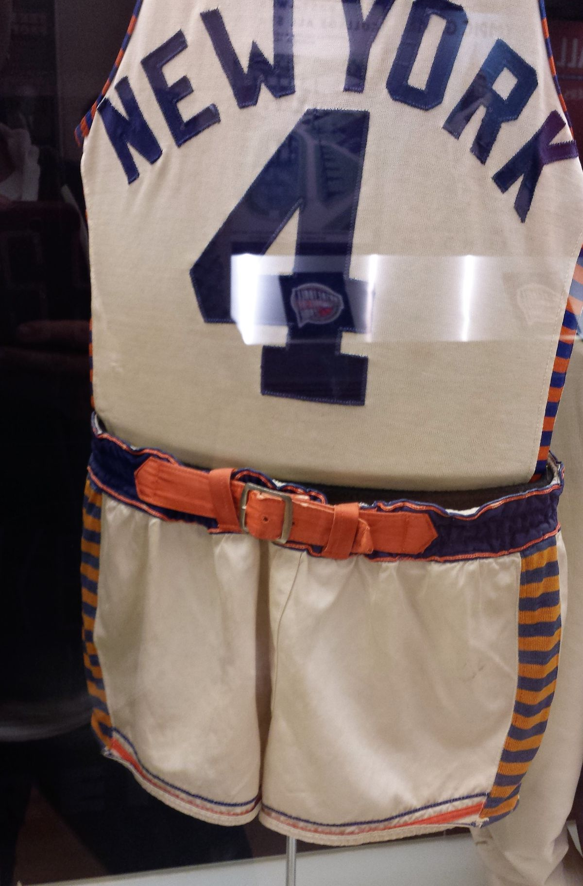New York Knicks jersey with a sturdy belt at the waist.