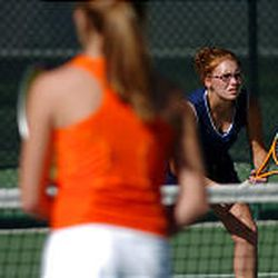 Mandie Divino, 15, gets ready for a return against teammate Brittney Neilson, 17, in a doubles match at Juan Diego High School in Draper.