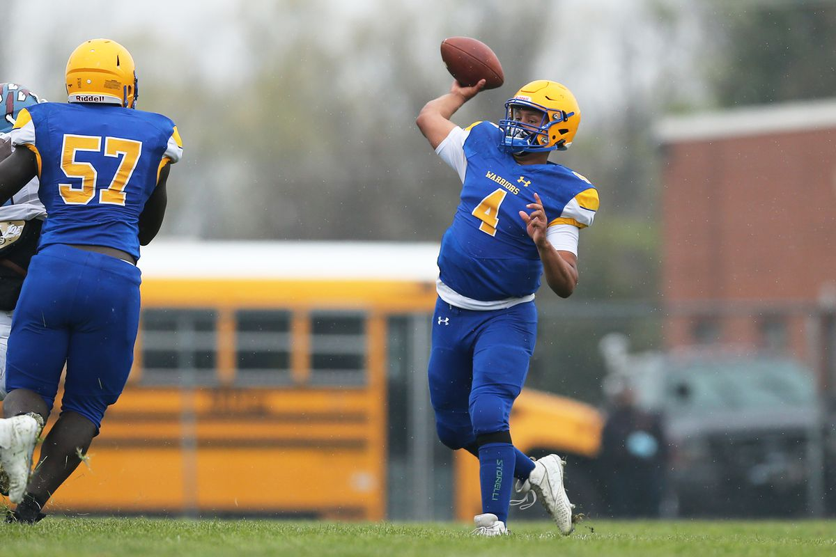 Crete-Monee's Charles Smith (4) throws a pass against Kankakee.