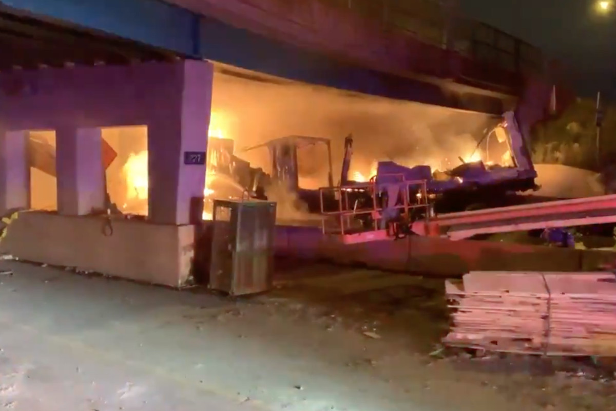 Firefighters extinguish a blaze Friday morning on the Tri-State Tollway at St. Charles Road.