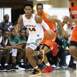Morgan Park's Adam Miller (44) brings the ball up court against Young.