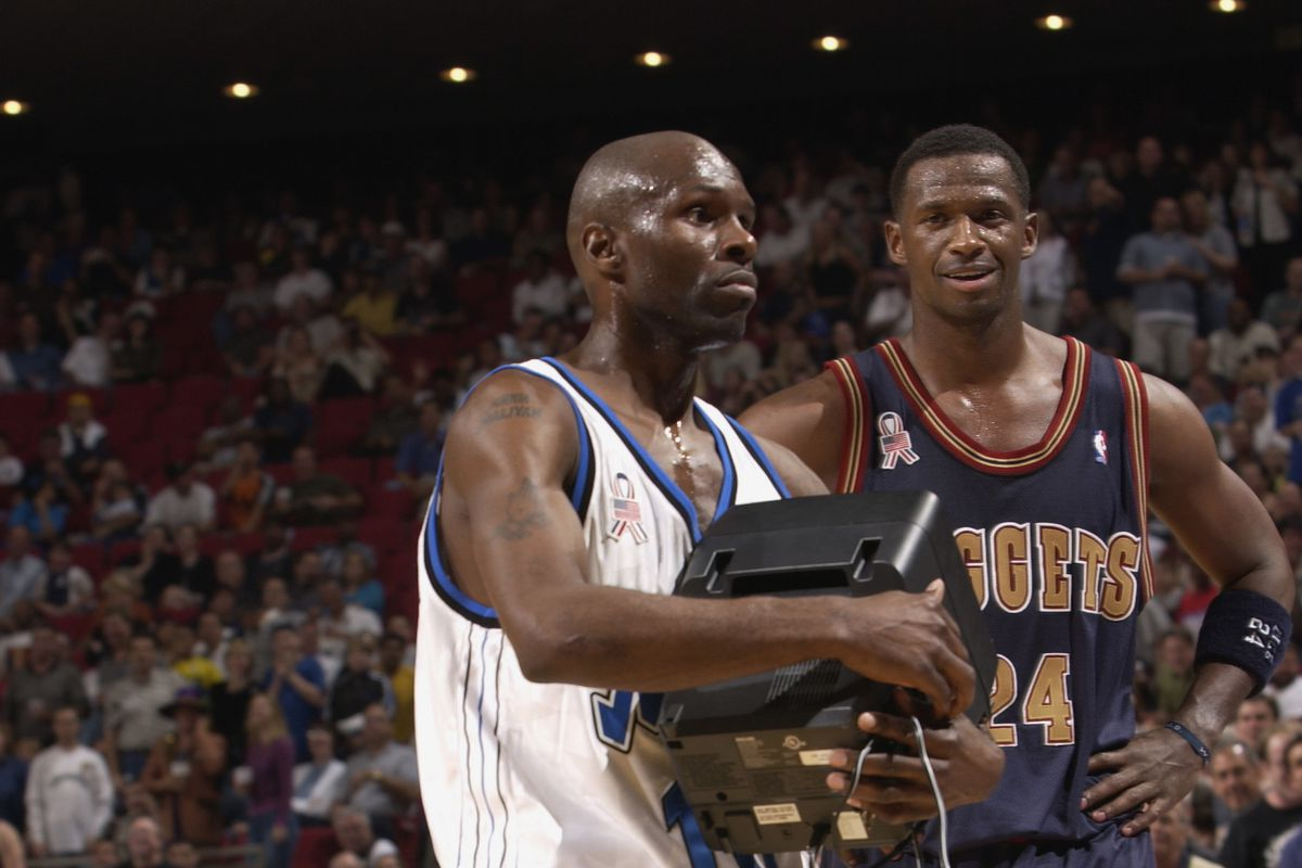 Darrell Armstrong carries a TV