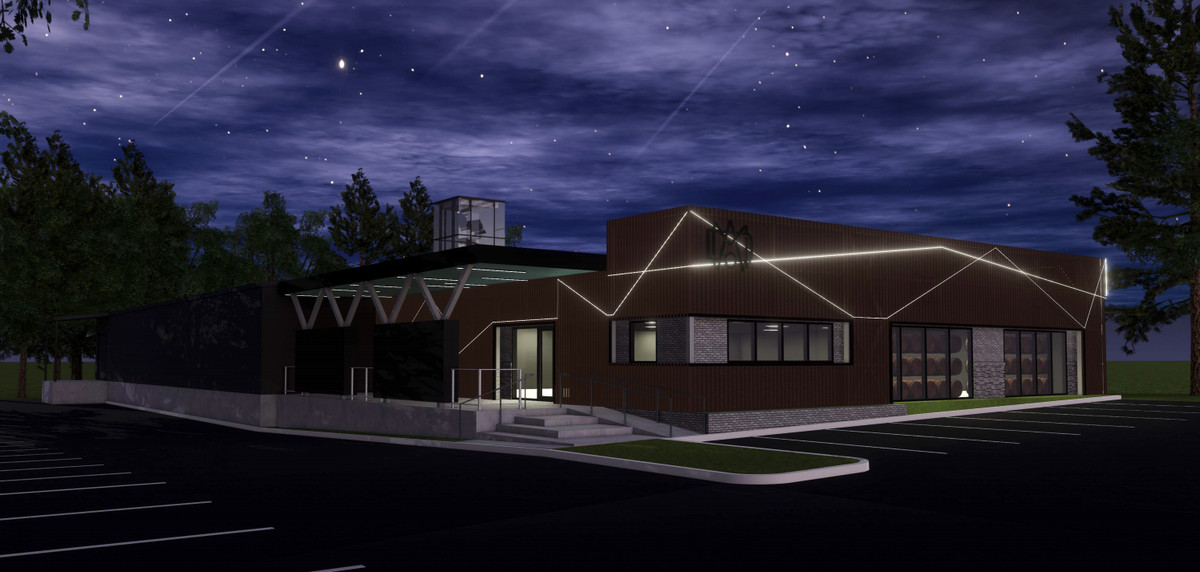 A rendering of the distillery at night