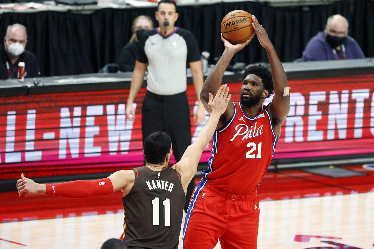 Philadelphia 76ers center Joel Embiid (21) shoots the ball over Portland Trail Blazers center Enes Kanter (11) during the second half at Moda Center.