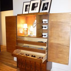 Reworked vintage cabinet featuring accessories