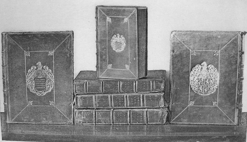 A set of old diaries on a table in a black and white photo.