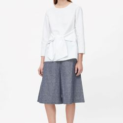 Cotton-linen blend shorts from Cos have a wide, culotte-style cut that will keep you cool despite the length.