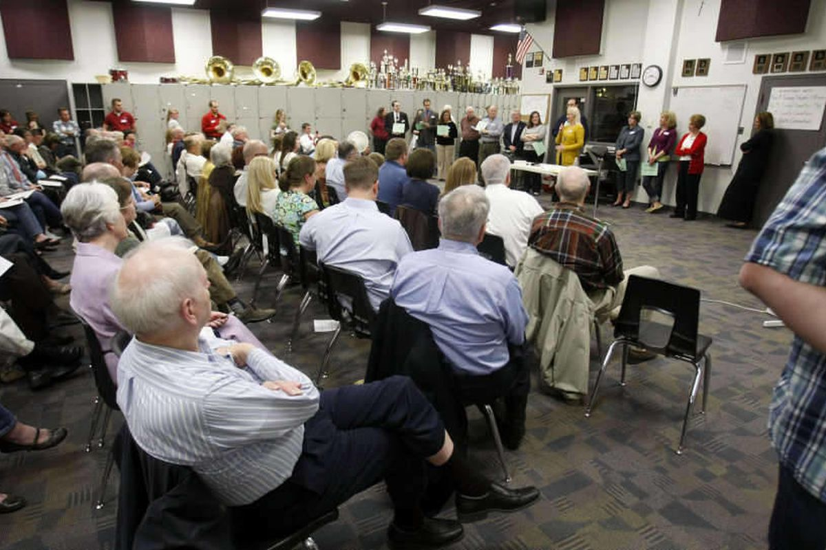 Residents attend the GOP Caucus meetings at Lone Peak High School in Highland, Thursday, March 15, 2012.\r\n