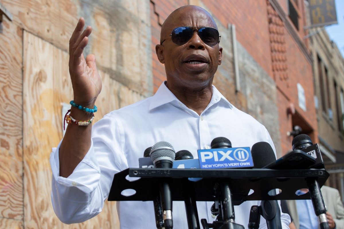 Brooklyn Borough President Eric Adams speaks outside a vacant Sunset Park hotel about supportive housing for homeless people, Sept. 20, 2021.