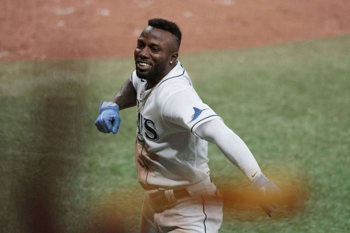 Randy Arozarena #56 of the Tampa Bay Rays celebrates after stealing home in the seventh inning against the Boston Red Sox during Game 1 of the American League Division Series at Tropicana Field on October 07, 2021 in St Petersburg, Florida.