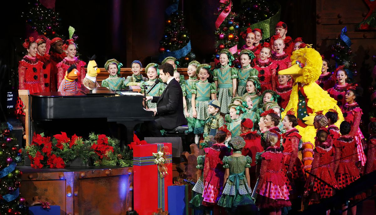 Santino Fontana and the Sesame Street Muppets perform with the Mormon Tabernacle Choir during their annual Christmas concert in Salt Lake City Friday, Dec. 12, 2014.