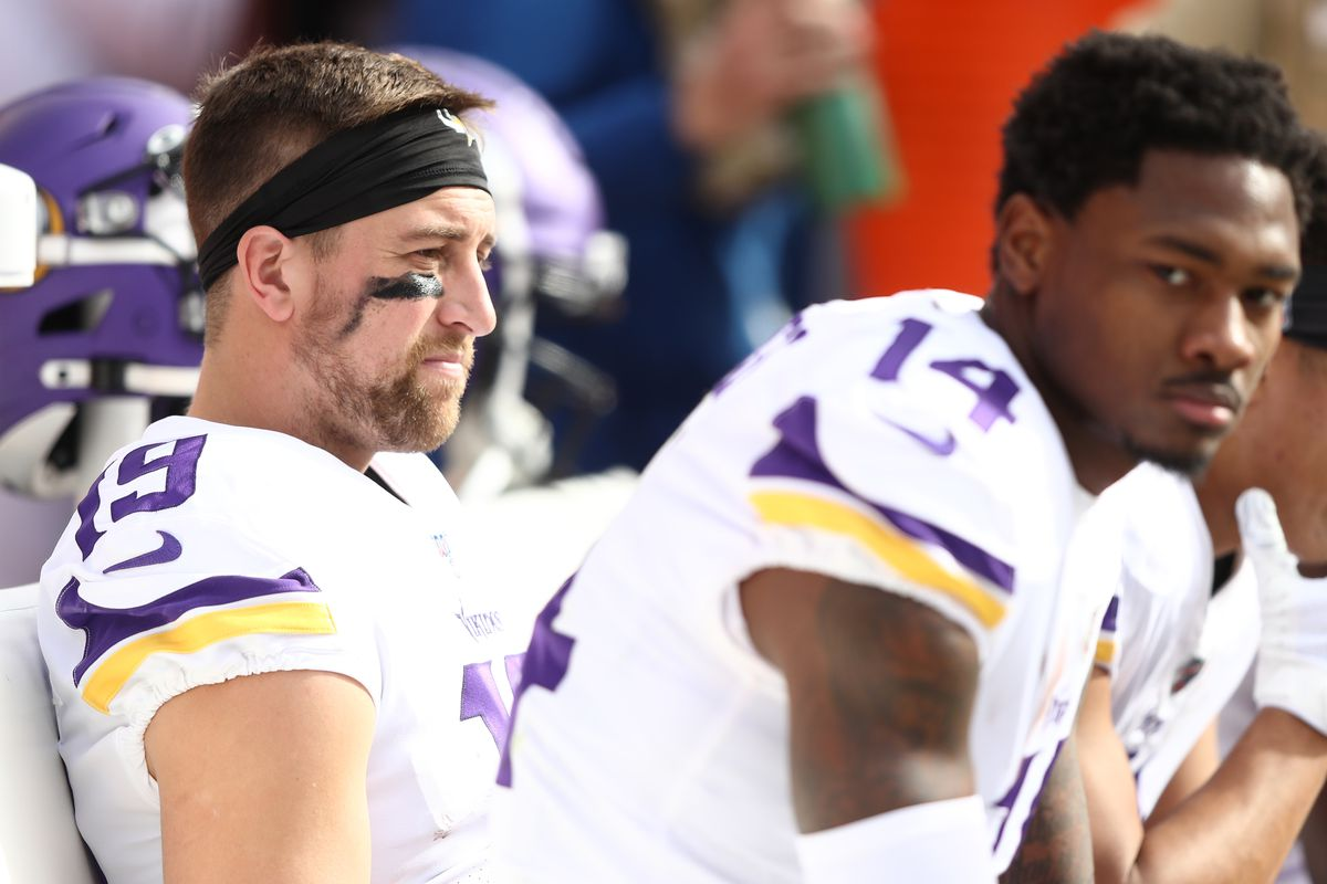 Adam Thielen and Stefon Diggs of the Minnesota Vikings look on from the sideline during the first half against the Kansas City Chiefs at Arrowhead Stadium on November 03, 2019 in Kansas City, Missouri.