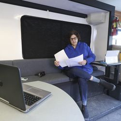 Salt Lake City Justice Courts Judge Jeanne Robison speaks with a prosecutor from her laptop from inside a borrowed Salt Lake police mobile command center used as a courtroom in Salt Lake City on Friday, March 27, 2020. Utah's criminal justice system is trying several new things in order to keep the courts running amid the novel coronavirus outbreak.