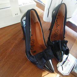 Black bow heels, $99