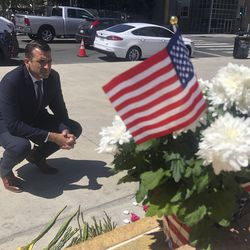 On May 27, San Jose Mayor Sam Liccardo stops to view a makeshift memorial for the rail yard shooting victims in front of City Hall in San Jose, Calif. San Jose officials passed a new gun law, that requires gun owners to carry liability insurance and pay a fee to cover taxpayers' cost associated with gun violence.