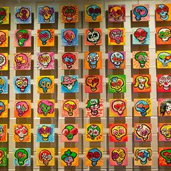 The Erni Vales sugar skulls artwork behind the hostess stand. Find all four members of KISS on here.