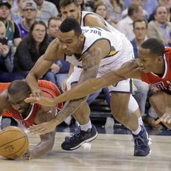 Utah Jazz forward Joel Bolomboy, center, battles with Los Angeles Clippers' Raymond Felton, left, and Wesley Johnson (33) for a loose ball in the second half during an NBA NHL hockey action in Winnipeg, Manitoba, Monday, Oct. 17, 2016. (John Woods/The Canadian Press via AP) basketball game, Monday, Oct. 17, 2016, in Salt Lake City. The Jazz won 104-78. (AP Photo/Rick Bowmer)