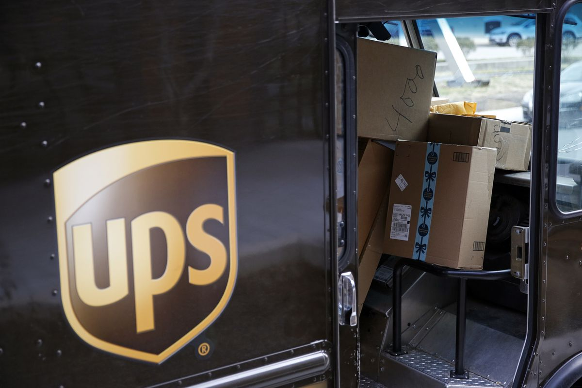 """FILE - In this Dec. 19, 2018, file photo packages await delivery inside of a UPS truck in Baltimore. United Parcel Service Inc. reported a 13% drop in first-quarter profit, to $965 million, as stay-at-home orders generated deliveries to people's homes but not enough to offset the higher costs and a drop in business deliveries. UPS said Tuesday, April 28, 2020 that the coronavirus outbreak has created """"significant headwinds."""" (AP Photo/Patrick Semansky, FIle)"""