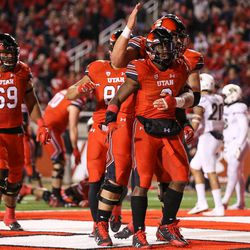 Utah Utes running back Zack Moss (2) celebrates his second touchdown of the night, putting the Utes up 14-0 over the Colorado Buffaloes after the PAT, at Rice-Eccles Stadium in Salt Lake City on Saturday, Nov. 25, 2017.