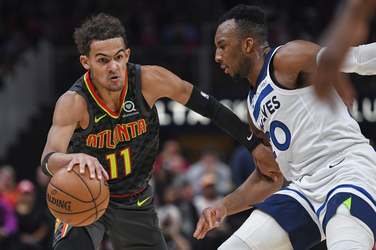Atlanta Hawks guard Trae Young dribbles against Minnesota Timberwolves guard Josh Okogie during the second half at State Farm Arena.