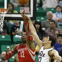 Utah Jazz's center Enes Kanter (0) battles Houston's Dwight Howard for the rebound as the Jazz and the Rockets play Saturday, Nov. 2, 2013 in EnergySolutions arena.